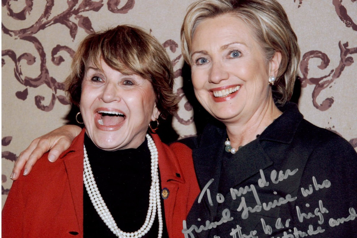 Louise Slaughter with Hilary Clinton posing with large smiles for the camera