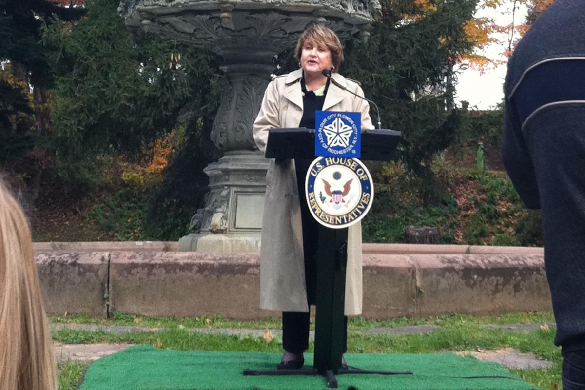 Louise Slaughter speaking at Mt. Hope cemetery in front of the Florentine fountain