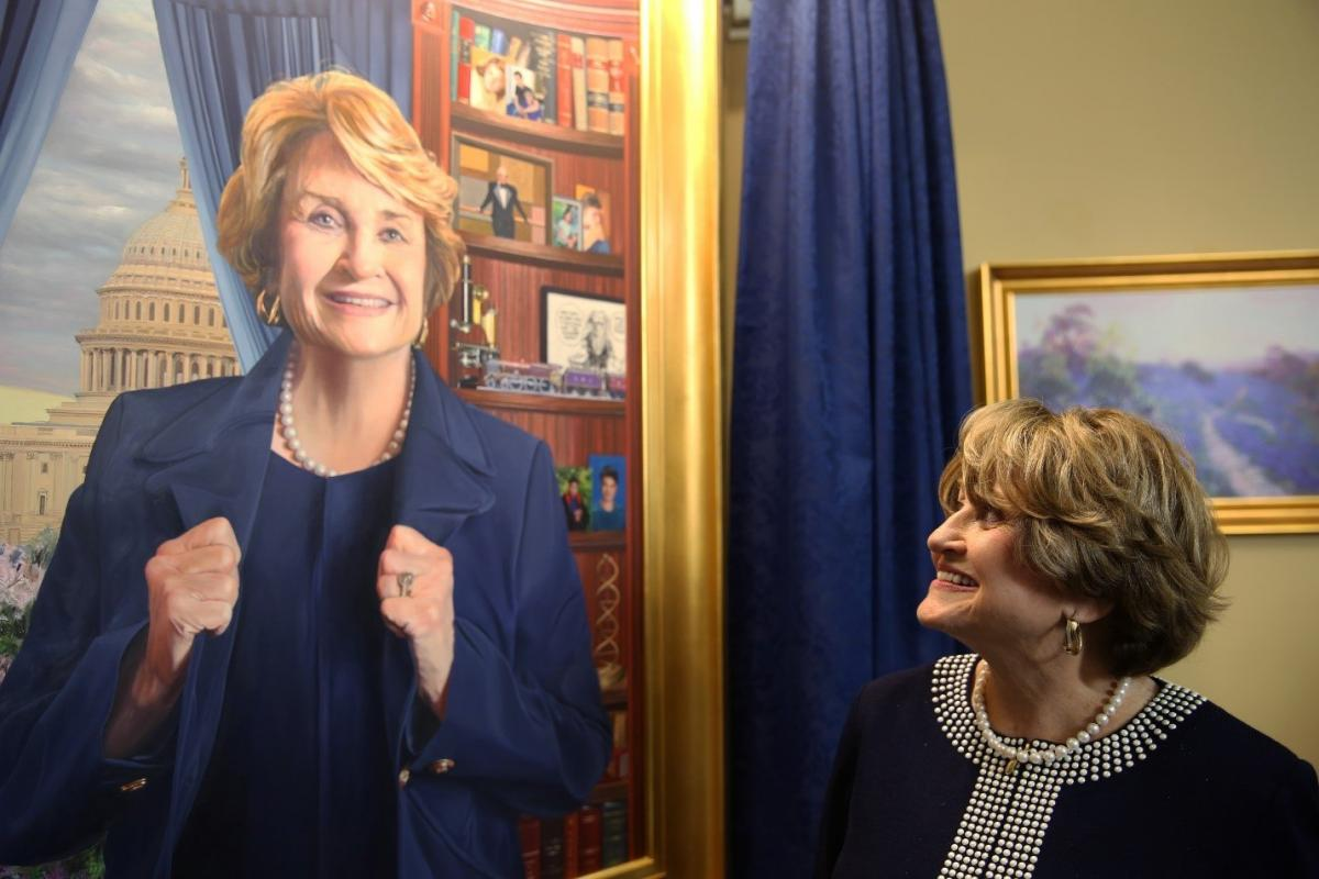 Louise Slaughter looking at a portrait of herself