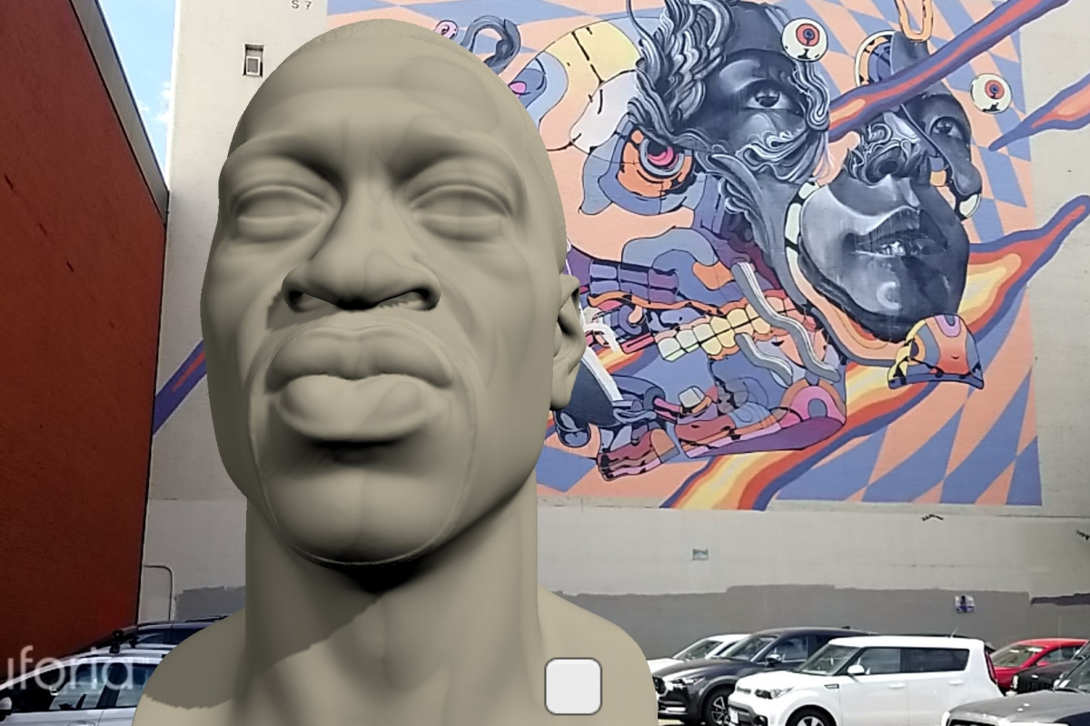 A virtual bust of George Floyd in front of a colorful mural in the Portland, Oregon
