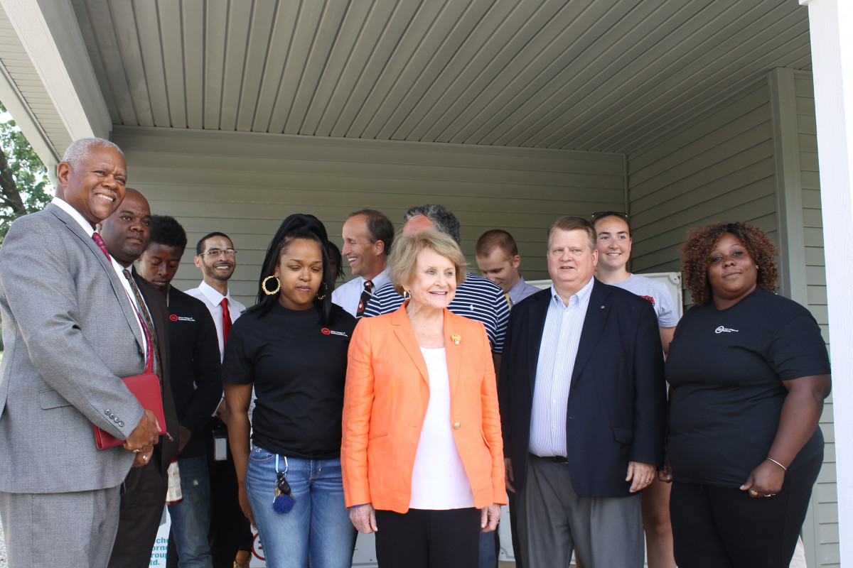 Louise Slaughter with a group of people at a YouthBuild site