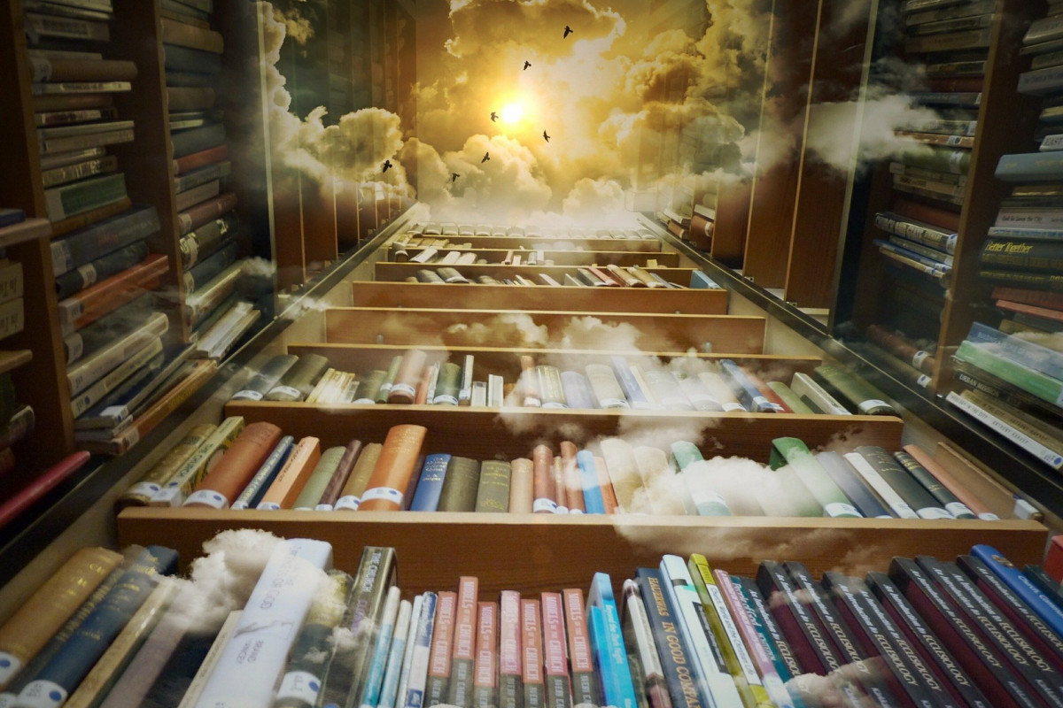Looking up at bookshelves that fade into to clouds and sky