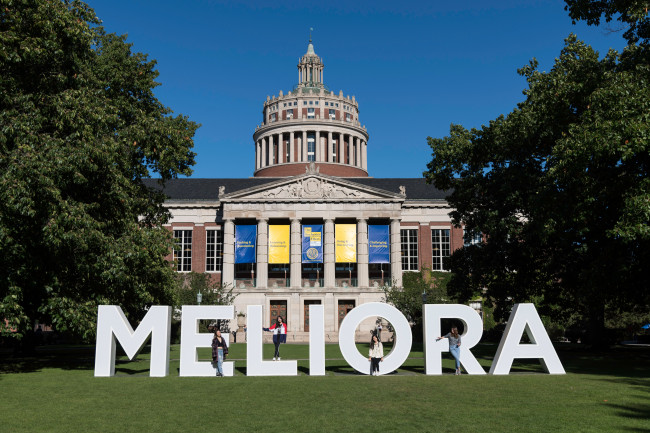 Large letters spelling out MELIORA in the quad in front of Rush Rhees Library