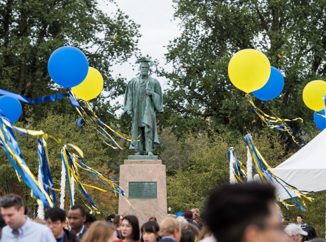 Statue of Martin Brewer Anderson surrounded by blue and yellow balloons