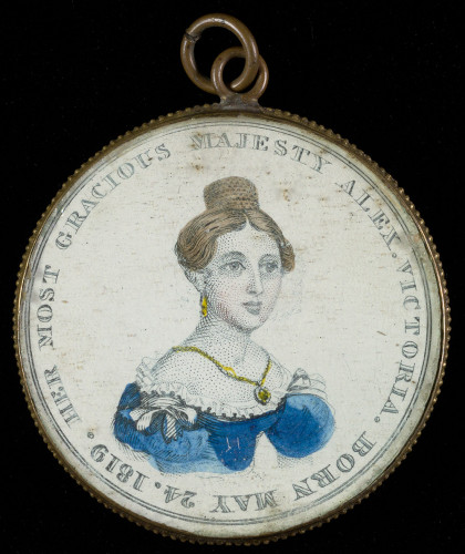 A pendant with an illustration of Queen Victoria on it
