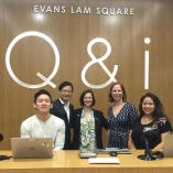 Q&i desk with Evan Lam, Mary Ann Mavrinac and other staff